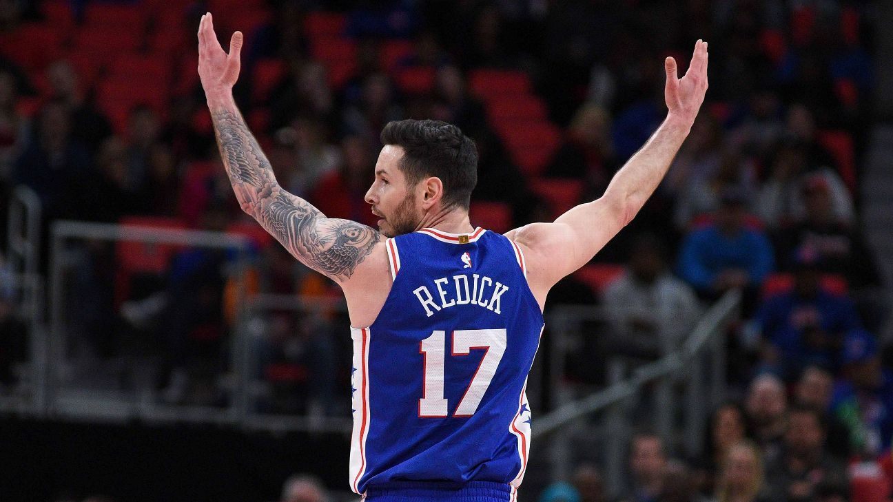 JJ Redick of the 76ers with his arms raised in frustration
